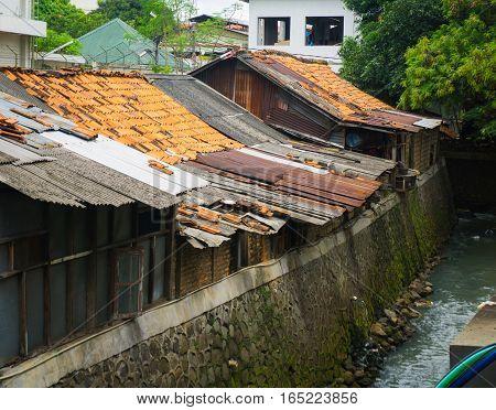 Slums near dirty ditch photo taken in Jakarta Indonesia java