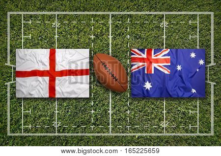 England vs. Australia flags on green rugby field, 3d illustration