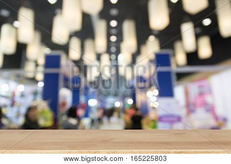 Trade Fair In Exhibition Hall, Booth Selling Cheap Goods From The Manufacturer With Wood Table For D