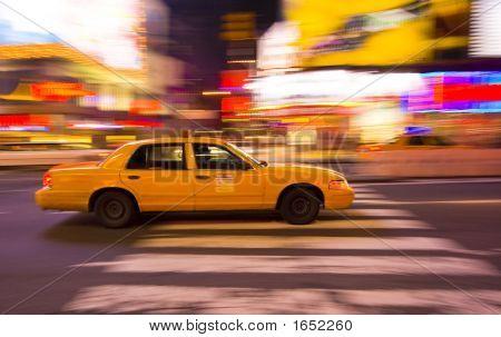 Taxi Cab Speeding Through New York City, With Motion Blur