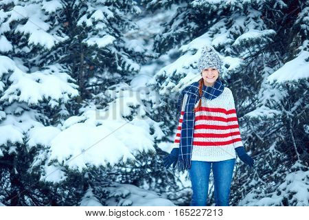 Portrait of happy young woman have fun at beautiful winter day