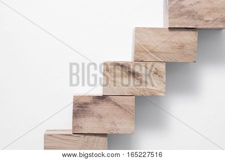 simple wooden blocks ladder with shadow isolated on white