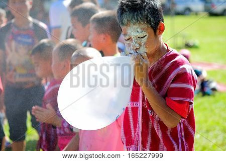 Chiangmai Thailand - January 13 2017: Children Karen're blowing up balloons game.On Children's Day in Northern Thailand.