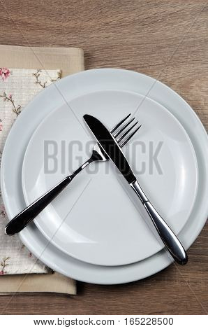 Dining etiquette - I still eat do not like. Fork and knife signals with location of cutlery set