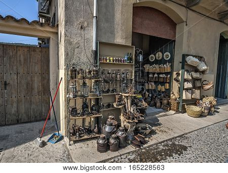 Spain Catalonia Girona Besalu. Causeway cobblestone street antique shop.