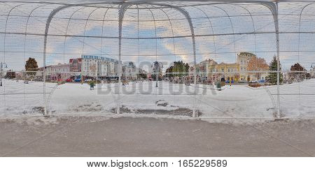 TÂRGU MUREȘ, ROMANIA - December 29, 2016: 360 panorama inside a giant Christmas ornament in winter daytime in a scnow-covered Piața Trandafirilor, town centre of Târgu Mureș, Romania