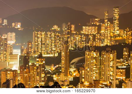 Blurred lights Hong Kong residence area over mountain background abstract background