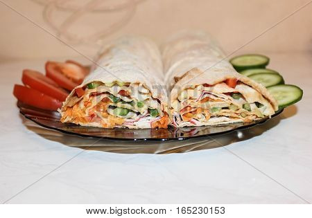 Festive roll from various vegetables on a dish