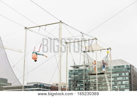 Washington DC, USA - September 24, 2016: Trapeze artists training outside in park