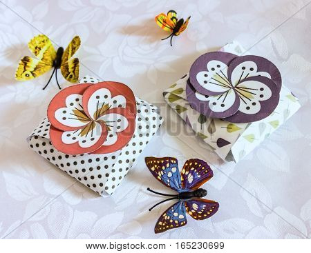 Original spring boxes and of different colors butterflies