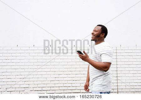 Cool African American Guy Walking With Mobile Phone