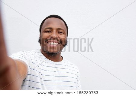 Smiling Young African American Man Taking Selfie