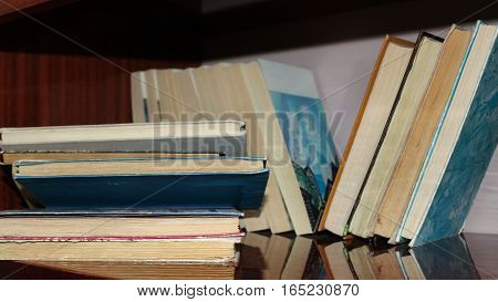 Pile of books stacked on a shelf