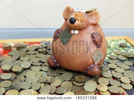Piggy bank in the form of a mouse for coins