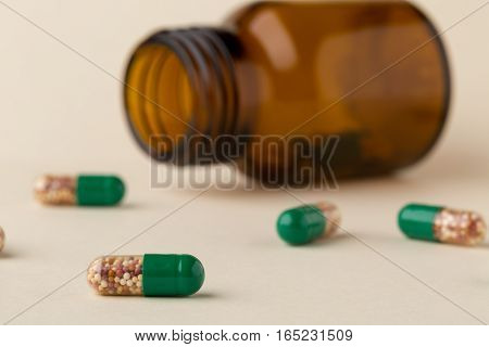 Bottle of pills from the brown glass and colorful capsules