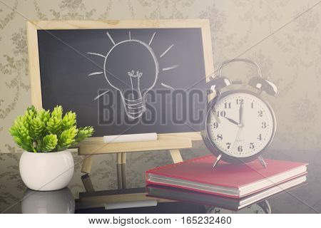 Idea concept on blackboard with flare effect