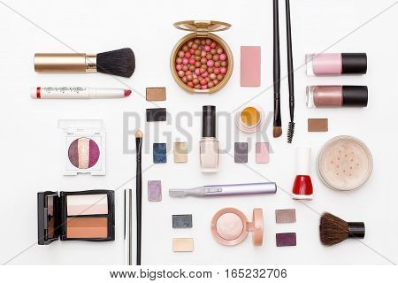 makeup cosmetics brushes lipstick nail Polish eyeshadow trimmer and other accessories on white background top view. beauty flat lay concept