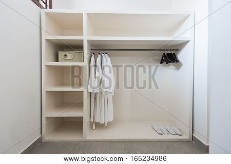 Bathrope, safe box and cloth hanger in wardrope.