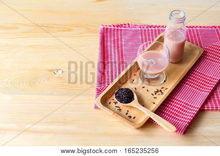 Jasmine rice drink for health on wooden background
