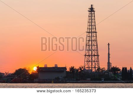 Sunrise over Oil refinery tower with clear sky background