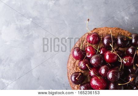 Chocolate cake with cherries on gray background. Cherries. Cherry. Fresh cherries. sweet food concept Copyspace