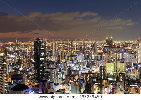Osaka city business downtown at night view from Umeda sky building Japan