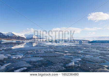 Ice breaking over Jakulsarlon lagoon with blue sky background during winter season Iceland