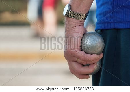 Senior playing petanque fun and relaxing game