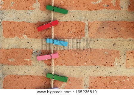 Clothes peg colorful clamps on the rope