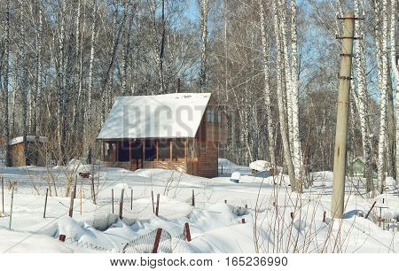 Snowbound country house in the early morning