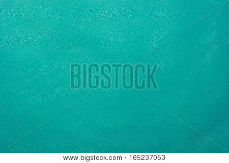 Turquoise colored leather texture background skin fabric