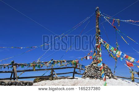 YUNNAN CHINA - APRIL 2015 Tibetan Buddhist prayer flags on the top of shika Snow Mountain