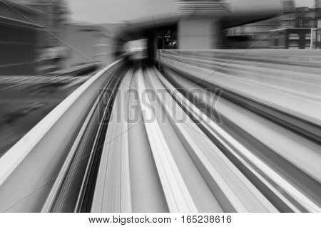 Black and White Motion blurred sky train moving to tunnel abstract background