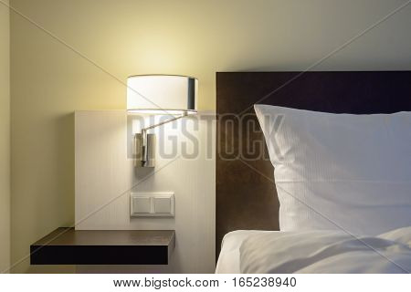 Wall lamp in modern bedroom - stock photo