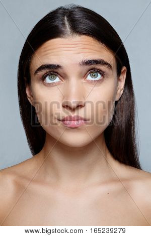 people luxury and fashion emotions concept - Portrait of young woman with shocked facial expression