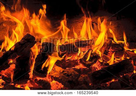 The blazing fire in fireplace. fire texture