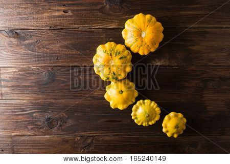 Yellow squash on a wooden background. Top view Colorful festive still life. Copyspace.