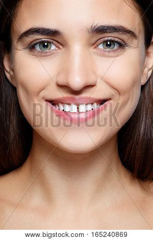 people luxury and fashion emotions concept - The young woman's portrait with happy emotions smile Closeup of beautiful brunette woman with pretty eyes and gap between teeth