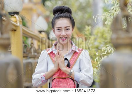 Beautiful Thai woman saluted with respectA beautiful young woman in a temple.