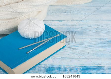 Knitted background with knitting needle and ball of yarn knit on book is hobby leisure activities of many people in free time also make many handmade product