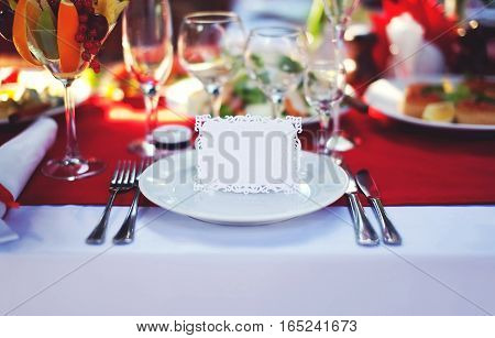 Beautiful decorated place at the table with the guest card on holiday empty copy space background