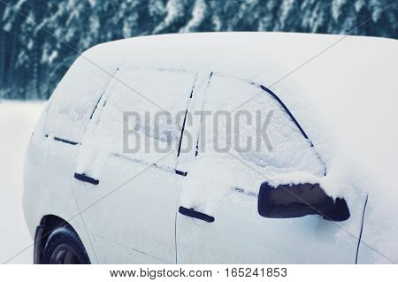 Frozen Car Covered Snow In Winter Day, View Side Window On Snowy Forest Background