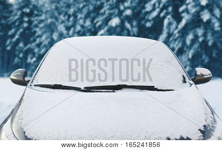 Frozen Car Covered Snow At Winter Day, View Front Window Windshield And Hood On Snowy Background
