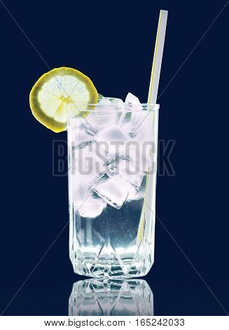 Refreshing Cocktail Glass With Ice Cubes And Lemon Slice Straw Tube Isolated On Background