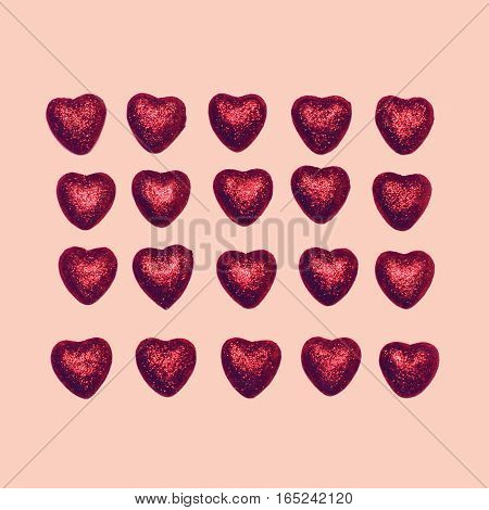 Sweet Many Red Decorative Candies Hearts Isolated On A Pink Background