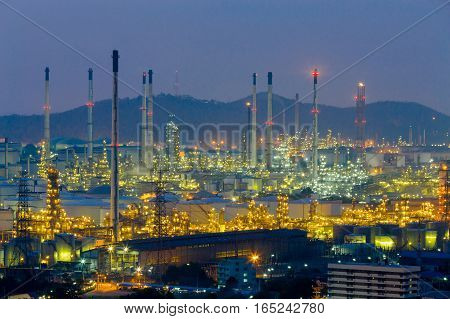 Oil refinery lights night view with mountain background