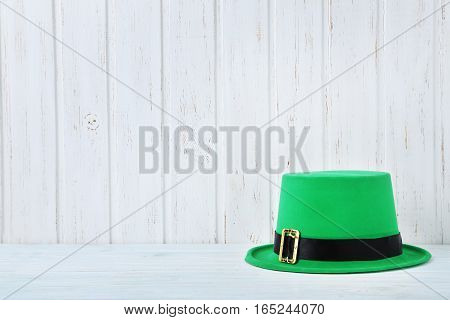 Green St. Patrick's Day Hat On White Wall Paneling Background