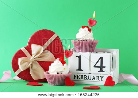 Tasty Cupcakes With Cube Calendar On Green Background