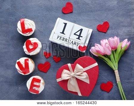 Tasty Cupcakes With Calendar And Tulips On A Grey Wooden Table