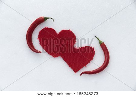 Two hot chili pepper love in a driven snow